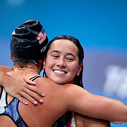 TOKYO, JAPAN - JULY 28: Winner Katie Ledecky of the United States is congratulated by silver medal winner and team mate Erica Sullivan of the United States after the 1500m final for women during the Swimming Finals at the Tokyo Aquatic Centre at the Tokyo 2020 Summer Olympic Games on July 28, 2021 in Tokyo, Japan. (Photo by Tim Clayton/Corbis via Getty Images)