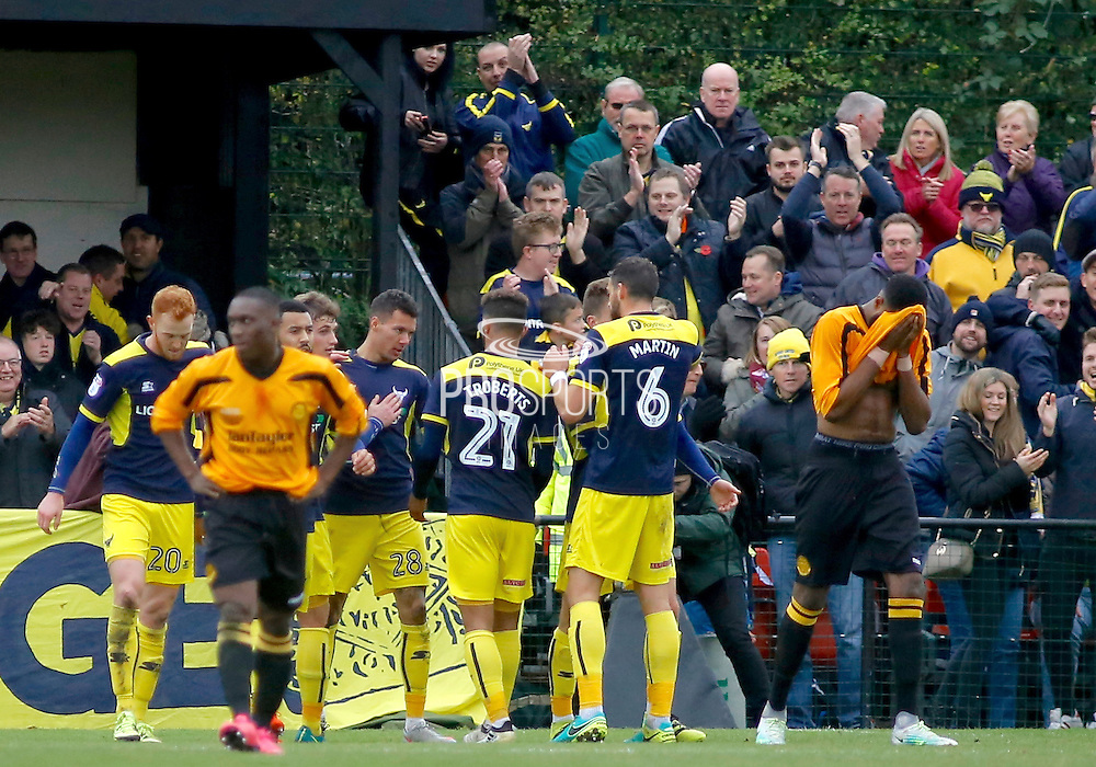 Oxford United players celebrate the second goal to make it 2-0 during the FA Cup match between Merstham and Oxford United at Moatside, Merstham, United Kingdom on 5 November 2016. Photo by Andy Walter.
