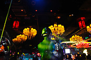 A security guard watches the floor at a nightclub in Shenzhen, China on 08 January 2010.