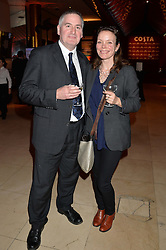CHRIS RIDDELL winner of the Costa Children's Book Award and his wife JO RIDDELL at the Costa Book Awards 2013 held at Quaglino's, 16 Bury Street, London on 28th January 2014.