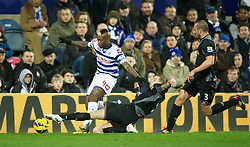 30.12.2012, Loftus Road, London, ENG, Premier League, Queens Park Rangers vs FC Liverpool, 20. Runde, im Bild Liverpool's Daniel Agger in action against Queens Park Rangers' Djibril Cisse during during the English Premier League 20th round match between Queens Park Rangers and Liverpool FC at Loftus Road, London, Great Britain on 2012/12/30. EXPA Pictures © 2012, PhotoCredit: EXPA/ Propagandaphoto/ David Rawcliffe..***** ATTENTION - OUT OF ENG, GBR, UK *****