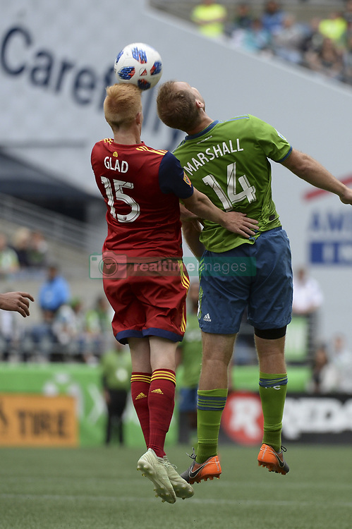 May 26, 2018 - Seattle, Washington, U.S - MLS Soccer 2018: Seattle's CHAD MARSHALL (14) and RSL's JUSTEN GLAD (15) go up to head the ball as Real Salt Lake visited the Seattle Sounders in a MLS match at Century Link Field in Seattle, WA. RSL won the match 1-0. (Credit Image: © Jeff Halstead via ZUMA Wire)