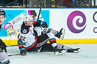 KELOWNA, BC - JANUARY 4: Dillon Hamaliuk #22 of the Kelowna Rockets falls to the ice after a check against the Vancouver Giants  at Prospera Place on January 4, 2020 in Kelowna, Canada. (Photo by Marissa Baecker/Shoot the Breeze)