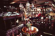 Forbes Island, a man-made floating island home in San Francisco Bay, Sausalito, California. Forbes Kiddoo at his bar.