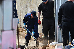 © Licensed to London News Pictures. 16/05/2017. London, UK. A Police search team use digging equipment on the ground. Police continue to search for the body of murdered schoolgirl Danielle Jones at a block of garages  in Stifford Clays in Thurrock, Essex. The 15-year-old was last seen on Monday June 18 2001 at about 8am when she left her home in East Tilbury to catch the bus to school.  Photo credit: Ben Cawthra/LNP