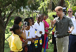 Prince Harry arrives for a visit to the Botanic Gardens in Kingstown, Saint Vincent and the Grenadines, during the second leg of his Caribbean tour.
