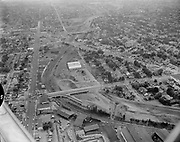 Y-560824-04. Aerial of NE 33rd overpass across Sullivan's Gulch during Banfield construction. Looking east, Sandy on right. August 24, 1956
