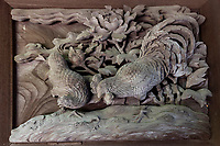 """Ioji Temple Wooden Bas Relief - Ioji Temple has been attributed somewhat erroneously to Kobori Enshu, who once visited the temple.  Ioji Temple gardens use the style of landscape gardening of the early Ido period using a very large space - an area of 1,000 square meters from the north garden to the reception hall once used for state ceremonies. There is a small garden in front of the main hall, just after the intricately carved wooden bas releif entrance gates, covered with moss called """"Moss Garden of Tokai""""."""