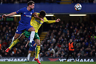 James Maddison of Norwich City (R) battles with Danny Drinkwater of Chelsea (L). The Emirates FA Cup, 3rd round replay match, Chelsea v Norwich City at Stamford Bridge in London on Wednesday 17th January 2018.<br /> pic by Steffan Bowen, Andrew Orchard sports photography.