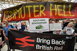 "© Licensed to London News Pictures. 11/07/2016. London, UK. Passengers stage a ""fare strike"" and protest at Victoria Station in central London in response to Southern Railway's owner, Govia Thameslink Railway, cutting 341 trains a day, 15% of services, to deal with industrial action and staff sickness. Photo credit : Stephen Chung/LNP"