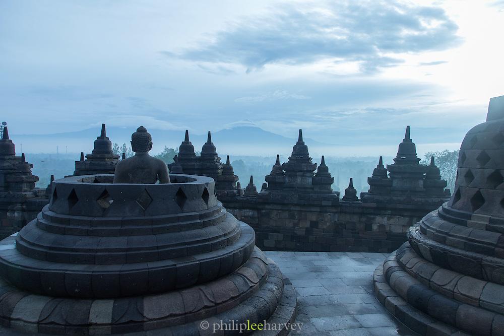 Statue of Buddha and stupas, Borobudur, Kedu Valley, South Central Java, Java, Indonesia, Southeast Asia