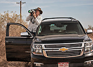 Sharon Wilson, Texas coordinator of Earthworks,  in the Permian Basin with FLIR camera at a fracking industry site doucmenting methane leaks.