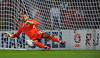 Scunthorpe United's Joe Anyon fails to keep out a penalty taken by Barnsley's Marc Roberts during the penalty shoot out<br /> <br /> Photographer Chris Vaughan/CameraSport<br /> <br /> Football - Capital One Cup First Round - Scunthorpe United v Barnsley - Tuesday 11th August 2015 - Glanford Park - Scunthorpe<br />  <br /> © CameraSport - 43 Linden Ave. Countesthorpe. Leicester. England. LE8 5PG - Tel: +44 (0) 116 277 4147 - admin@camerasport.com - www.camerasport.com