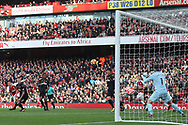 Alexis Sanchez of Arsenal (L) takes a shot at goal but sees it saved by Swansea City Goalkeeper Lukasz Fabianski of Swansea City (R). Premier league match, Arsenal v Swansea city at the Emirates Stadium in London on Saturday 28th October 2017.<br /> pic by Steffan Bowen, Andrew Orchard sports photography.