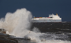 © Licensed to London News Pictures. <br /> 01/02/2015. <br /> <br /> South Gare, Redcar, United Kingdom<br /> <br /> The container ship Wilhelmine enters Teesport during big seas South Gare near Redcar in Teesside.<br /> <br /> Photo credit : Ian Forsyth/LNP