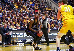 Mar 20, 2019; Morgantown, WV, USA; Grand Canyon Antelopes forward Oscar Frayer (4) pauses before shooting during the first half against the West Virginia Mountaineers at WVU Coliseum. Mandatory Credit: Ben Queen
