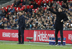 BRITAIN-LONDON-FOOTBALL-CHAPIONS LEAGUE-HOTSPUR VS EINDHOVEN.(181106) -- LONDON, Nov. 6, 2018  Tottenham Hotspur's manager Mauricio Pochettino (L) and Eindhoven's Mark Van Bommel instructs during the UEFA Champions League match between Tottenham Hotspur and PSV Eindhoven in London, Britain on Nov. 6, 2018. Tottenham Hotspur won 2-1.  FOR EDITORIAL USE ONLY. NOT FOR SALE FOR MARKETING OR ADVERTISING CAMPAIGNS. NO USE WITH UNAUTHORIZED AUDIO, VIDEO, DATA, FIXTURE LISTS, CLUBLEAGUE LOGOS OR ''LIVE'' SERVICES. ONLINE IN-MATCH USE LIMITED TO 45 IMAGES, NO VIDEO EMULATION. NO USE IN BETTING, GAMES OR SINGLE CLUBLEAGUEPLAYER PUBLICATIONS. (Credit Image: © Xinhua via ZUMA Wire)