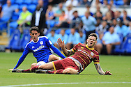 Ben Gladwin of Queens Park Rangers is fouled by Peter Whittingham of Cardiff city (l). EFL Skybet championship match, Cardiff city v Queens Park Rangers at the Cardiff city stadium in Cardiff, South Wales on Sunday 14th August 2016.<br /> pic by Andrew Orchard, Andrew Orchard sports photography.