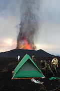 Tourist trip from hell: Witness lava fountains up close with an overnight trek to an erupting volcano<br /> <br /> Guidebooks often boast of explosive scenery which will blow your mind.<br /> But for one group of trekkers their trip certainly lived up to its promise, as they got up close to an erupting volcano.<br /> Staff at Virunga National Park carried out a new overnight trek to the site of the Nyamulagira volcano eruption in eastern Democratic Republic of Congo and hikers even got to set up camp to watch the fiery scene.<br /> The new tented camp for visitors is located just south of the erupting volcano in a close but in a safe area, selected by volcanologist Dario Tedesco with the Goma Volcanological Observatory.<br /> The volcanic eruption, which can last days or months, has not shown signs of slowing and staff plan on continuing the daring treks until it dies out.<br /> A similar eruption in 1989 continued for nine months while the last eruption in January 2010 ended after a few days.<br /> <br /> Following the trek, Dr Tedesco said: 'This is definitely the best and most spectacular eruption of Nyamulagira I have ever seen.<br /> 'The 200-300 meter lava fountains, the closeness and the arrangement of the camping site, and finally the incredible show given by the lights of the incandescent lava made everything special, more than special.'<br /> Virunga National Park warden, Emmanuel de Merode, spent the first night at the tented camp.<br /> He said: 'It was the most extraordinary experience. Given the exceptional nature of this volcanic eruption, we've concentrated our efforts into securing this area for visitors to reinforce Virunga's potential as the most spectacular park in Africa.'<br /> Virunga National Park, with the help of the European Union, has driven a major effort to relaunch tourism in Eastern Congo over the past two years. <br /> Access to volcanic eruptions has never been offered to visitors before, but is now possible thanks close collaboration with scientific experts from the Volcanological Observatory in Goma.<br /> The national