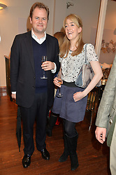 The HON.MICHAEL MARSHAM and his wife the HON.LUCY MARSHAM  at a pre christmas party & shopping evening at Patrick Mavros, 104-106 Fulham Road, London on 26th November 2014.