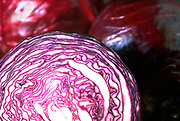 Selective focus close up of a few heads of Red Cabbage with one cut in half