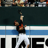 08 June 2007:  Baltimore Orioles center fielder Jay Payton leaps at the wall and fails to catch a solo home run off the bat of Colorado Rockies catcher Yorvit Torrealba in the 5th inning .  The Orioles defeated the Rockies 4-2 in interleague play at Camden Yards in Baltimore, MD.   ****For Editorial Use Only****
