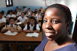 Black woman teacher in classroom at Carlos J Finlay secondary school; Havana; Cuba,
