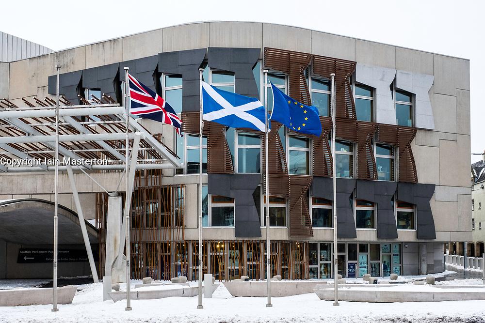 Flags flying outside Scottish Parliament building at Holyrood in Edinburgh, Scotland, United Kingdom