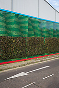 The wrap-around construction hoarding of the Tideway Sewer Tunnel dominates a surrounding Rotherhithe street, on 16th January 2020, in London, England.