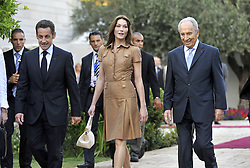Israeli President Shimon Peres (R) welcomes his French counterpart Nicolas Sarkozy (L) and first lady Carla Bruni-Sarkozy at the Israeli presidential residence in Jerusalem, Israel on June 22, 2008, at the start of Sarkozy's three-day state visit to Israel and the Palestinian Territories. Photo by Eric Feferberg/Pool/ABACAPRESS.COM