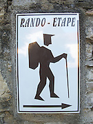 A Rando-Etape notice where walkers can find basic accommodation for the night. Similar signs can frequently be found near the main walking routes in France such as the GR65 route from Le Puy en Velay to Saint Jean Pied de Port.