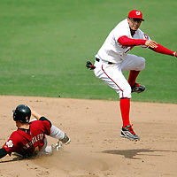 18 July 2007:  Washington Nationals shortstop Felipe Lopez (2) leapsa and completes a double play as Houston Astros shortstop Eric Bruntlett (4) slides into second base on a ball hit by pinch hitter Orlando Palmeiro.  The Nationals defeated the Astros 7-6 at RFK Stadium in Washington, D.C.  ****For Editorial Use Only****