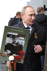 May 9, 2017 - Moscow, Russia - May 9, 2017. - Russia, Moscow. - Russian President Vladimir Putin with the portrait of his father Vladimir Spiridonovich Putin, a war veteran, taking part in the patriotic march, Immortal Regiment, which is devoted to the 72nd anniversary of the Victory in the Great Patriotic War of 1941-1945. (Credit Image: © Russian Look via ZUMA Wire)