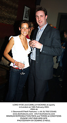 LORD HYDE and CAMILLA HACKING at a party in London on 18th February 2004.<br /> PRW 46