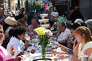 Hoxton, Hackney, London. Street party to celebrate 1948 Olympic games on the day the Olympic flag was handed to London for 2012 Games.