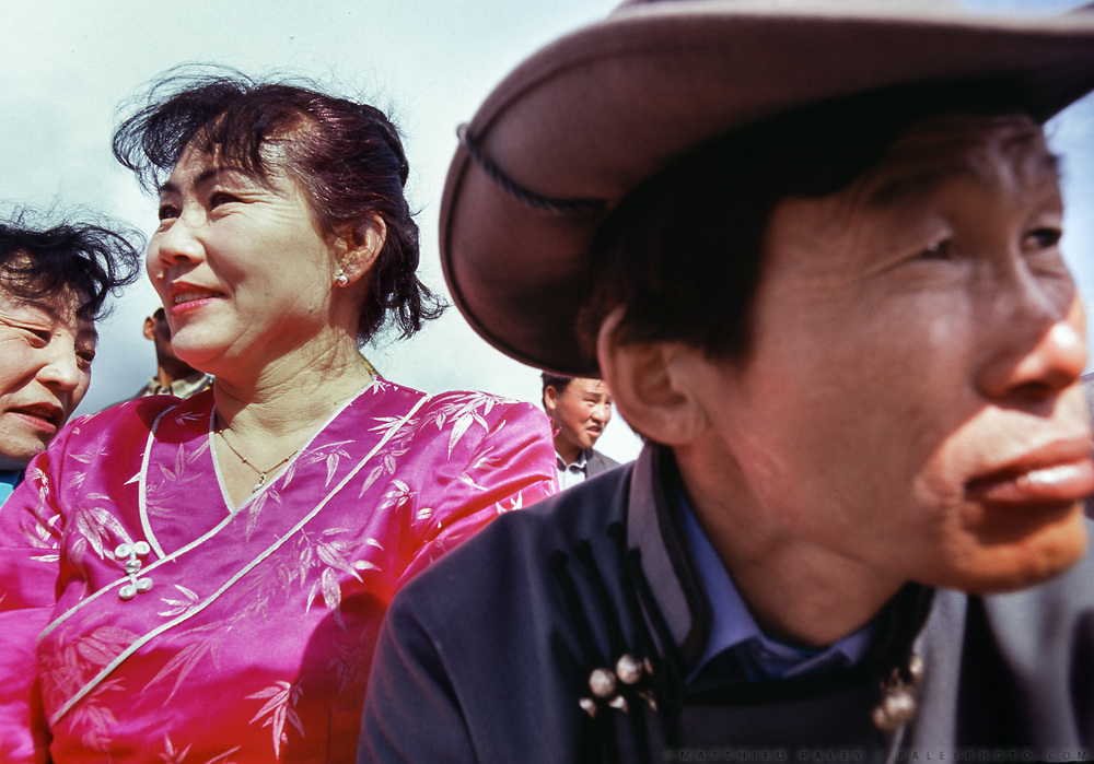 Traditional Mongolian dress and cowboy style hat.<br /> More than a hundred people traveled by horse and foot to hear Mongolia's high Lama speak at a ceremony honoring the placement of the first stone for the Dayan Derkh monastery, which is currently being rebuilt in Khövsgöl Province. The original structure was destroyed in 1938 by Soviet purges.