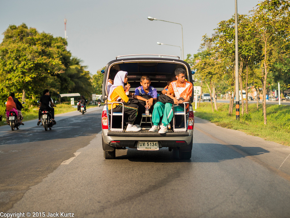 19 JUNE 2015 - PATTANI, PATTANI, THAILAND:   Thai students on a pickup truck converted use as a school bus in the southern province of Pattani, Thailand. PHOTO BY JACK KURTZ