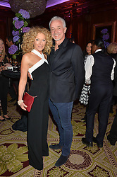 "KELLY HOPPEN and JOHN GARDINER at the presentation of Le Prix Champagne De La Joie de Vivre to Stephen Webster in celebration of his long standing contribution to ""Joie de Vivre' held at the Council Room, One Great George Street, London on 22nd April 2015."