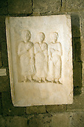 Grave stele  two males and a female figures from Nisyros Archaeological museum, Rhodes, Greece
