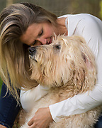 Dog mom with her special puppy have a precious moment during our session.