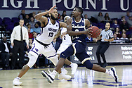 HIGH POINT, NC - JANUARY 06: Charleston Southern's Cortez Mitchell (2) and High Point's Jahaad Proctor (13). The High Point University of Panthers hosted the Charleston Southern University Buccaneers on January 6, 2018 at Millis Athletic Convocation Center in High Point, NC in a Division I men's college basketball game. HPU won the game 80-59.