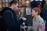 Local novelist Stella Duffy is interviewed while supporting the protest outside Carnegie Library in Herne Hill, south London while occupiers remain inside the premises on day 5 of its occupation. Duffy is a nearby resident and a passionate advocate for public libraries serving the underprivilaged. The angry local community in the south London borough have occupied their important resource for learning and social hub for the weekend. After a long campaign by locals, Lambeth have gone ahead and closed the library's doors for the last time because they say, cuts to their budget mean millions must be saved.