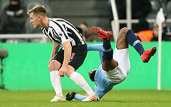 Newcastle United's Matt Ritchie (left) and Manchester City's Raheem Sterling collide