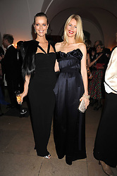 Left to right, EVA HERZIGOVA and CLAUDIA SCHIFFER at Chaos Point - a fashion show from Viienne Westwood's Gold Label Collection in aid of the NSPCC at The Banqueting House, London SW1 on 18th November 2008.
