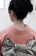 back view of young woman wearing a kimono