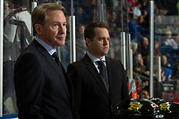 KELOWNA, BC - MARCH 03: Portland Winterhawks' head coach and GM, Mike Johnston stands on the bench next to associate coach and assistant GM, Kyle Gustafson, against the Kelowna Rockets  at Prospera Place on March 3, 2019 in Kelowna, Canada. (Photo by Marissa Baecker/Getty Images)