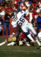 SAN FRANCISCO, CA-1991:  NFL linebacker Lawrence Taylor of the New York Giants rushes the quarterback during the 1991 NFC Championship game against the San Fransisco 49'ers at Candlestick Park, San Francisco, CA.    Taylor played for the Giants from 1981-1993.  (Photo by Ron Vesely)