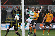 Yeovil's Ryan Bird strikes the ball into straight into the arms of Newport's keeper Joe Day. Skybet football league two match, Newport county v Yeovil Town at Rodney Parade in Newport, South Wales on Saturday 21st November 2015.<br /> pic by David Richards, Andrew Orchard sports photography.