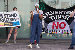 London, UK. 5th June, 2021. Naima Omar of Stand Up To Racism addresses environmental activists and local residents protesting against the construction of the Silvertown Tunnel. Campaigners opposed to the controversial new £2bn road link across the River Thames from the Tidal Basin Roundabout in Silvertown to Greenwich Peninsula argue that it is incompatible with the UK's climate change commitments because it will attract more traffic and so also increased congestion and air pollution to the most polluted borough of London.