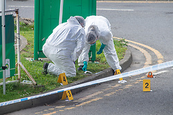© Licensed to London News Pictures. 01/04/2021. Reading, UK. Forensic investigators gather evidence on Chalfont Way, Lower Earley, Reading following a serious incident of assault outside a BP petrol station which occurred at approximately 7:40pm on Wednesday 31/03/2021, a 51-year-old man was taken to the Royal Berkshire Hospital in a critical condition with life-threatening injuries. Photo credit: Peter Manning/LNP